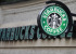 A sign is seen outside a Starbucks Coffee shop in central London